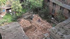 Nepal manual labor, worker scraping bricks in old courtyard in Kathmandu Stock Footage
