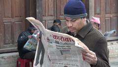 Men read newspapers on the streets of Kathmandu, Nepal press freedom Stock Footage