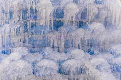 Waterfall with ice in a blue and white color in winter Stock Photos