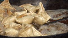 Frying samosa, a popular snack in South Asia, on a market in Kathmandu Stock Footage