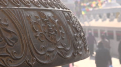 Nepal religion, Buddhism, prayer bell, pilgrims, Boudhanath stupa, detail Stock Footage