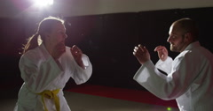 Two young martial arts athletes practice their moves. - stock footage