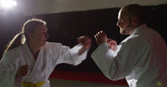 Two young martial arts athletes practice their moves in slow motion. Stock Footage
