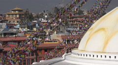 Boudhanath stupa, prayer flags, hotels, monastery, Kathmandu, Nepal Stock Footage
