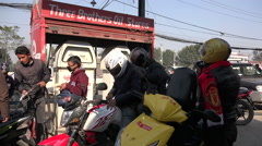 Motorbikes fill their tanks at a petrol station in Kathmandu, Nepal Stock Footage