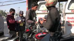 Petrol station in Kathmandu, motorcycles fill up their gas tank, Nepal Stock Footage