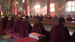 Monks in maroon robes, prayer ceremony, monastery in Kathmandu, Nepal - stock footage
