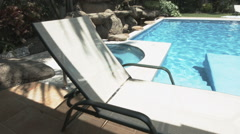 A sun bed by the pool Stock Footage