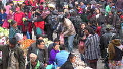Busy crowded fruit and vegetable market in old Kathmandu city, Nepal - stock footage