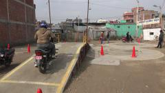Motorbike rider, lessons, drivers' license, practice, track in Kathmandu, Nepal - stock footage