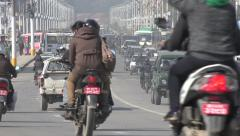 Motorbikes and other traffic on highway in central Kathmandu Stock Footage