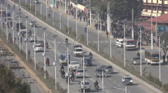 Traffic drives over highway in Kathmandu, solar powered streetlights, Nepal Stock Footage