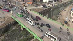 Intersection, bridge over polluted river, central Kathmandu, Nepal Stock Footage