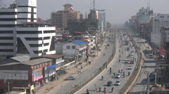Motorbikes and other traffic on highway central Kathmandu, Nepal Stock Footage