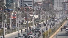 Traffic drives through a busy street in central Kathmandu, Nepal Stock Footage