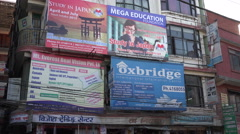 Billboards advertise to study abroad, Kathmandu streets, education, Nepal, Asia Stock Footage