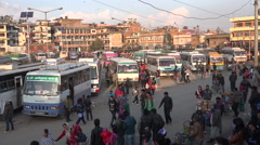 Passengers walk across the main bus station in Kathmandu, Nepal Stock Footage