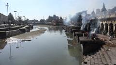 Nepal religion, public cremations, sacred Bagmati river, Hinduism, Kathmandu Stock Footage