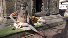 Posing sadhu in temple complex in Kathmandu, Hinduism, religion, Nepal Stock Footage