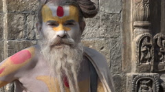 Nepal religion, portrait of a colorfully painted sadhu in Kathmandu Stock Footage