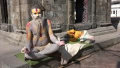 Meditating sadhu, a holy person, in temple complex in Kathmandu, Nepal Stock Footage