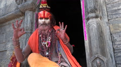 Hinduism in Nepal, sadhu (holy) man posing, portrait, religion, Kathmandu Stock Footage