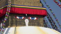 Nepal, Kathmandu, 'all seeing eyes' of the Boudhanath (stupa), Buddhism Stock Footage