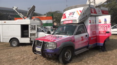 India broadcast trucks, press vans, live coverage, news reporting, journalism Stock Footage