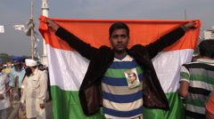 India nationalism, man holds flag during political gathering in Kolkata Stock Footage