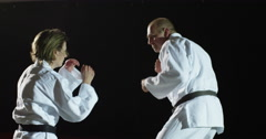 Two martial artists on a mat in slow motion. Stock Footage