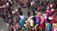Buying sari dresses in a busy shopping market in Kolkata, India - stock footage
