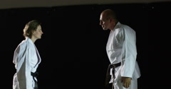 Two martial artists bow before their practicing in slow motion. Stock Footage