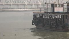 A ferry sails towards the Howrah bridge in Kolkata Stock Footage
