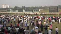 Kolkata horse racing tracks, running horses, crowd, audience, grandstand, India Stock Footage
