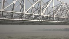 Sailing under the Howrah bridge on a ferry, in Kolkata, India Stock Footage