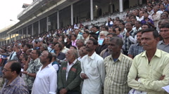 Audience at a horse racing track, spectators, betting, crowd, Kolkata, India Stock Footage