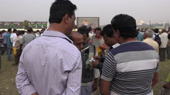 Discussing a horse race at the tracks in Kolkata, India Stock Footage
