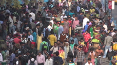 India transport, busy entrance to railway station, train passengers, Kolkata - stock footage