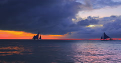 Beautiful marine nature with backlit boats at late evening with dramatic clouds Stock Footage
