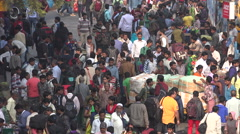 Crowded entrance to the Howrah railway station in Kolkata, India Stock Footage
