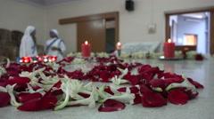 Three (defocused) nuns at the tomb of Mother Teresa in Kolkata, India Stock Footage