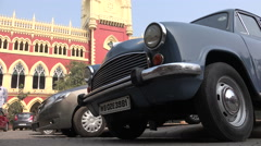 Classic Indian car in front of the Kolkata High Court Stock Footage