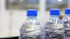 Plastic water bottles on conveyor Stock Footage