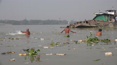 India religion, ritual bathing in polluted river, Hooghly, Kolkata Stock Footage