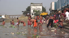 India religion, Hinduism, ritual bathing, people, Hooghly river, Kolkata - stock footage