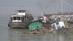 India, Kolkata, ferry passengers, Howrah bridge, sunken vessels Stock Footage