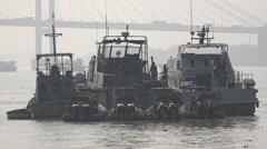 Customs speedboats on Kolkata river, combat illegal activity, India Stock Footage