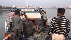 Passengers on a small ferry cross the river in Kolkata, India Stock Footage