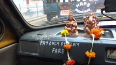 Religious statues in taxi in Kolkata, India Stock Footage