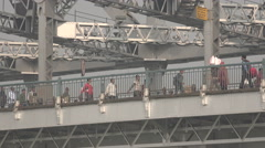 Commuters on the Howrah bridge in Kolkata, India Stock Footage